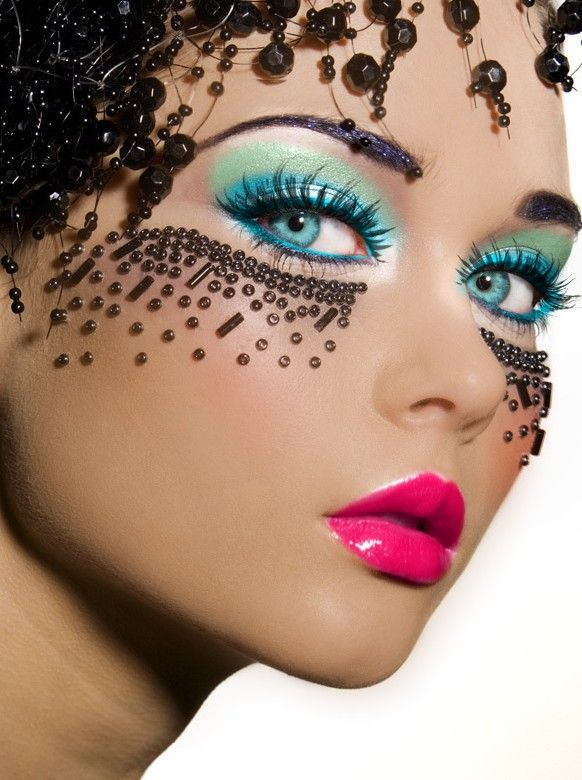 bright makeup with bead accents