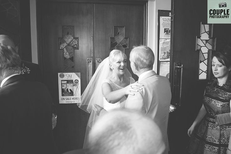 Candid photo of guests greeting the bride. Weddings at The Johnstown Estate, photographed by Couple Photography.