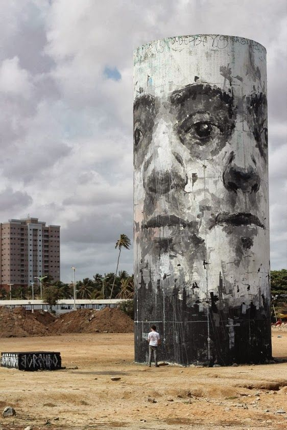 Street art at the beach in Fortaleza, Brazil, by Spanish street artist Borondo.