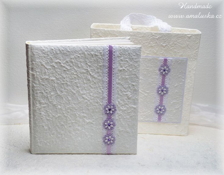 Wedding photo album with handmade paper laces, satin ribbon and flowers.