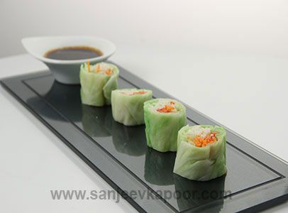 Noodle Roll - Noodles, carrot and capsicum rolled in blanched cabbage leaves and served with a ginger and green chilli dip.