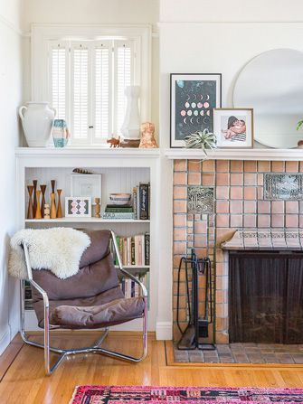 """A Homepolish Pro's Stylish Abode — & How You Can Copy It #refinery29  http://www.refinery29.com/homepolish-san-francisco#slide1  """"In my living room, I took cues from the aqua-toned tiles in my fireplace to outfit my shelves with a pink and aqua color palette. I love when a simple palette can serve as such a well-tuned filter for what accents to buy — isn't that moon phases print perfect? To maintain the palette, I even turn around all book spines that don't fit, like reds, yellows, and ..."""