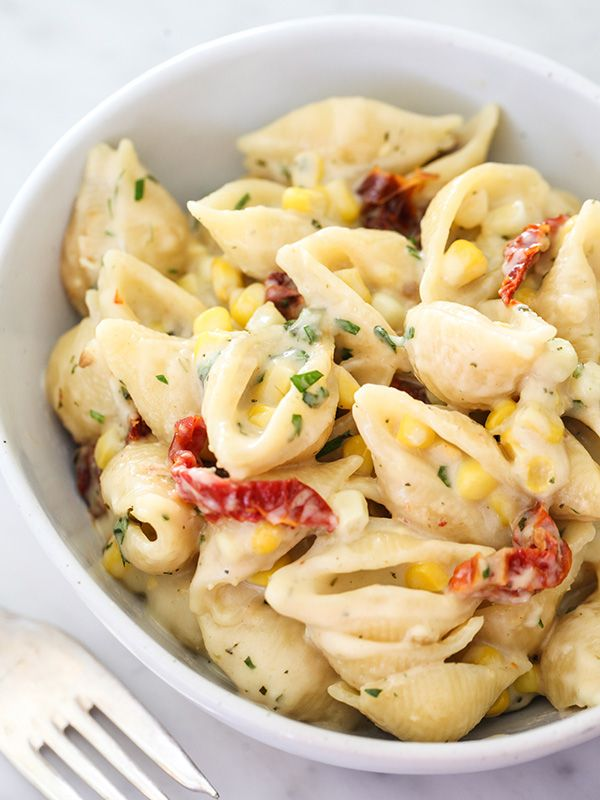 Stovetop Pesto Macaroni and Cheese with Corn and Sun-Dried Tomatoes