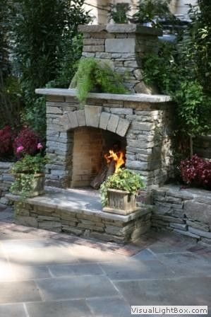 sandstone in landscaping | Landscaping natural stone outdoor fireplace with stone wall and ...