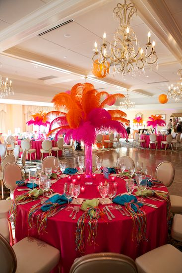 I'm thinking instead of bright colored feathers, use white or a neutral to match your wedding colors!