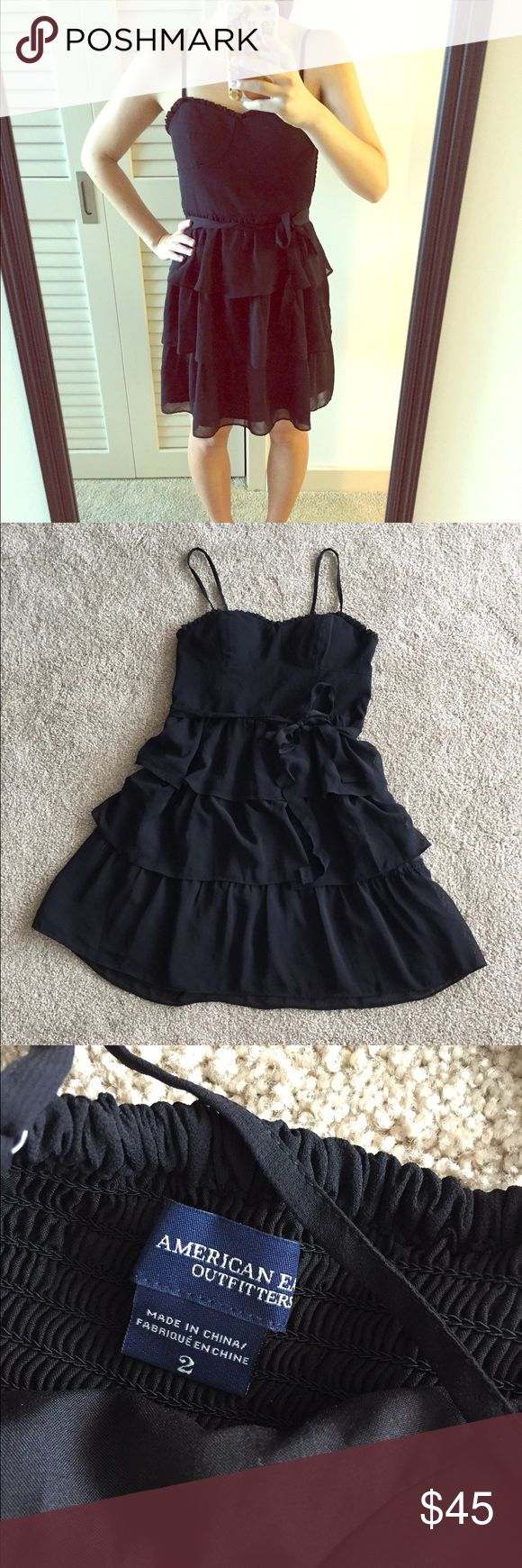 Black bow American Eagle dress. Black bow American Eagle dress. Gently used in good condition. No trades. Adjustable straps and built in cups. Please ask all questions before purchasing and use the offer button thanks! American Eagle Outfitters Dresses #americaneagleoutfitters