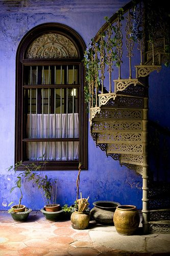 love the outside steps and that amazing wall color: Wall Colors, Spirals Staircases, Penang Malaysia, Spirals Stairs, Purple, Window, Blue Wall, Wrought Irons, Stairways