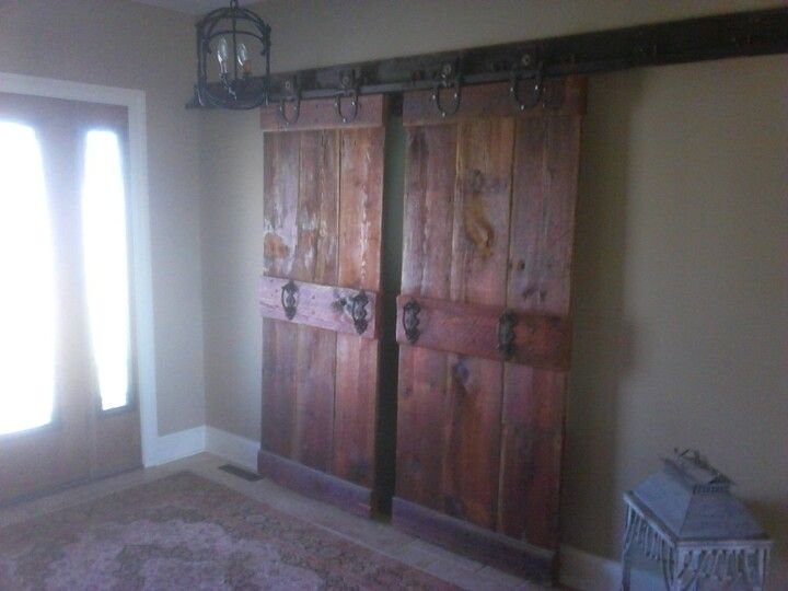 another look at this beautiful pair of custom made barn doors hanging on a track with barn door rollerswood
