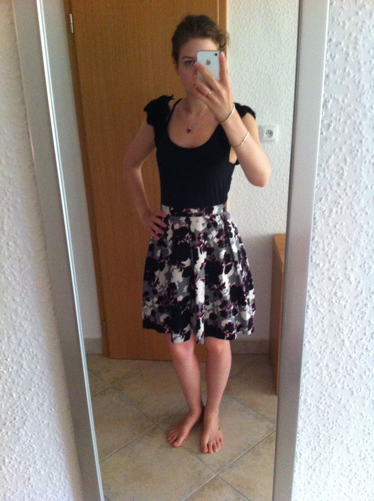 Floral skirt, black blouse. Enjoy Youself