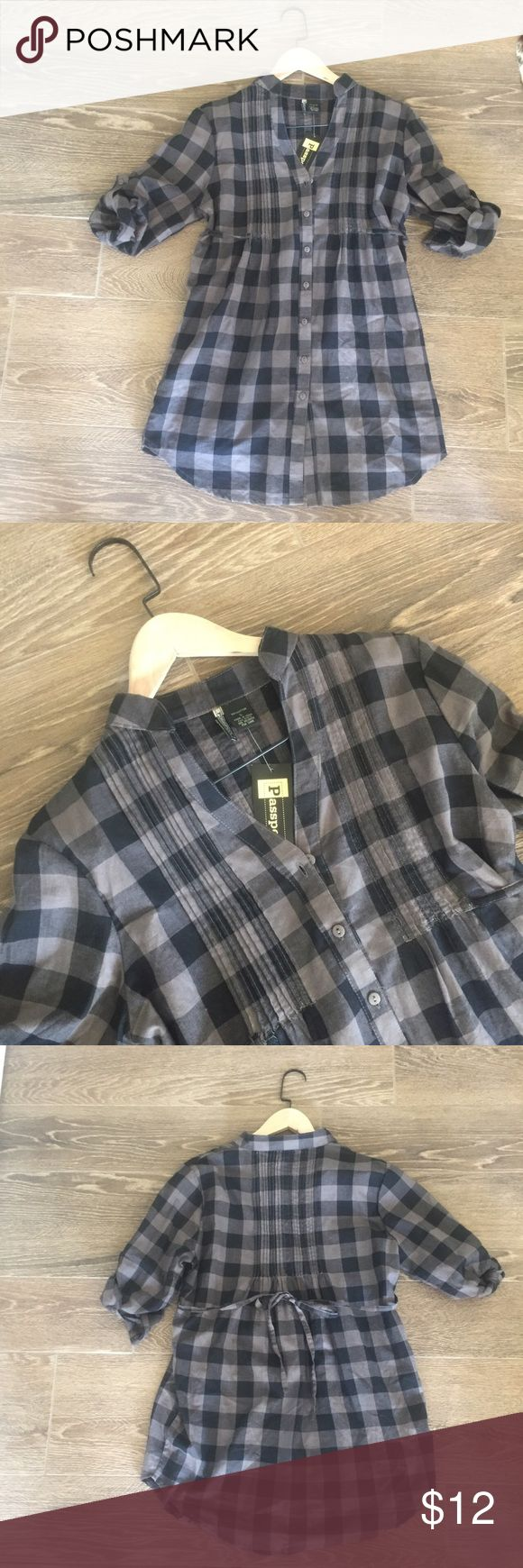 """NWT Passport Brown Plaid Shirt Dress sz Large NWT Passport button down shirt dress size Large. Brown and black plaid. Collarless with a v front. Attached belt that ties to the back. Button back sleeves. Would be Cute with leggings or boots or heels or flats. 31"""" shoulder to bottom hem #dress #plaid #shirtdress #womens #juniors Passport Dresses Midi"""