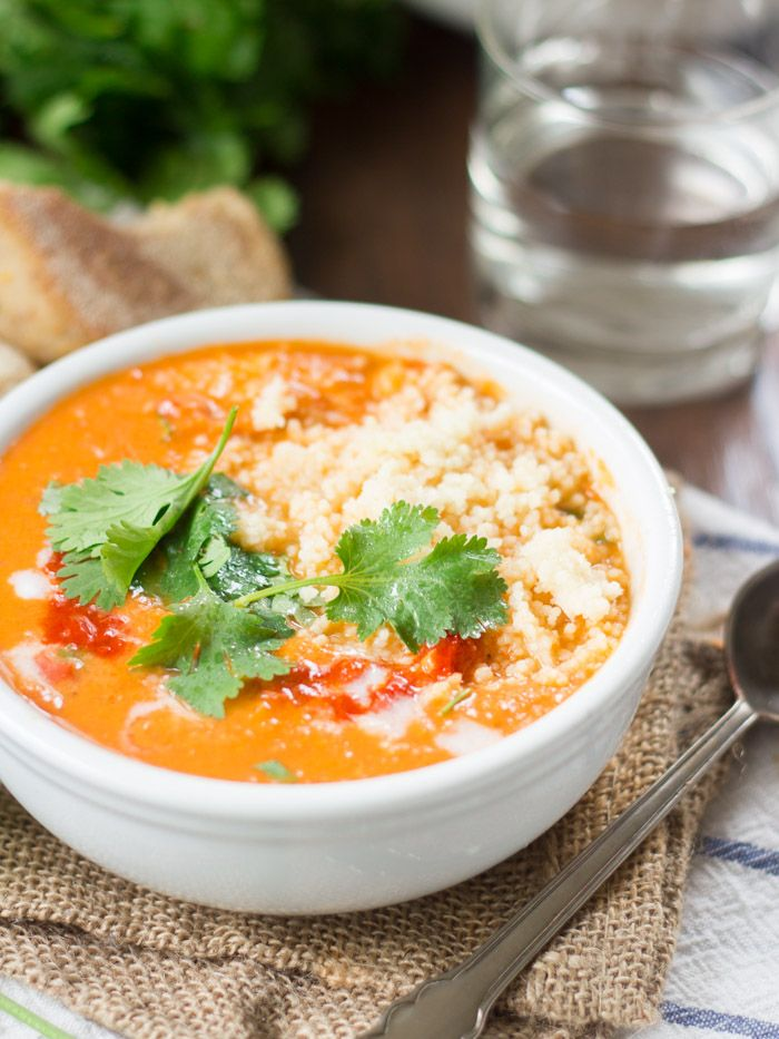 This rich and creamy roasted tomato soup is made with a creamy coconut milk base, seasoned up with spicy harissa paste and served with a dollop of couscous.