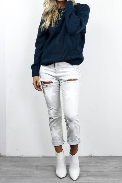 Light denim jeans are distressed with star details Material is Cotton and Spandex Not Lined Model Megan is 5'8 wearing a small Width Length Inseam WaistBand Sm
