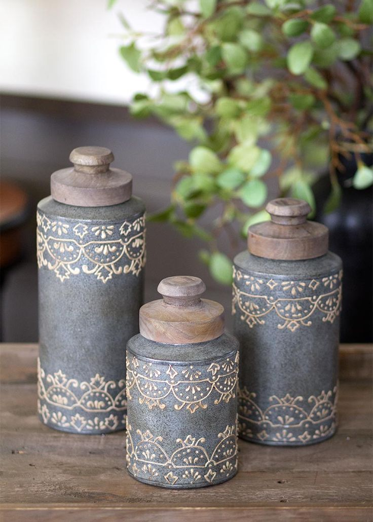 Set of three graduated canisters are perfect for your artisan home. The unique design and texture will make these conversation pieces!