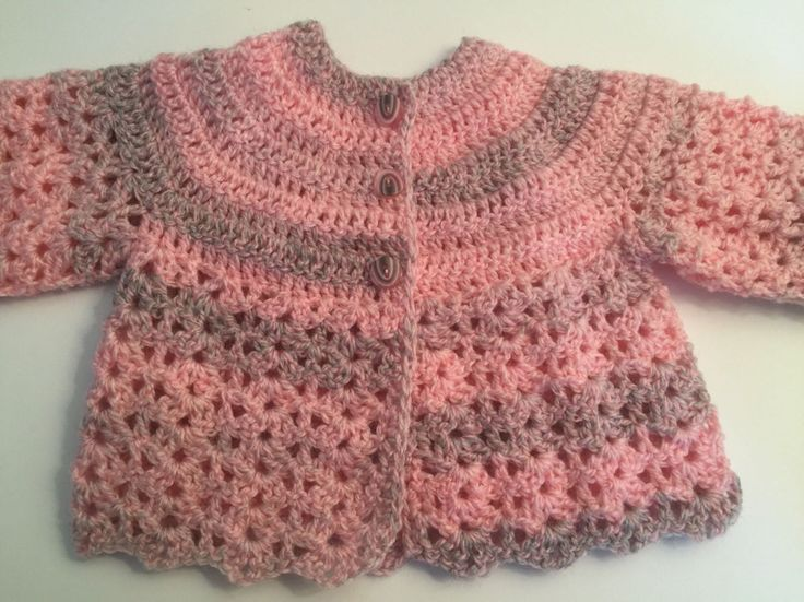 A personal favourite from my Etsy shop https://www.etsy.com/uk/listing/386978510/crochet-handmade-pinkgrey-baby-matinee