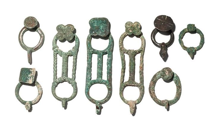 Iranian bronze belt latches, Amlash 1st millenium B.C. Ira, Iranian bronze belt latches, bronze stylised bird belt latches, 10 cm long max. Private collection