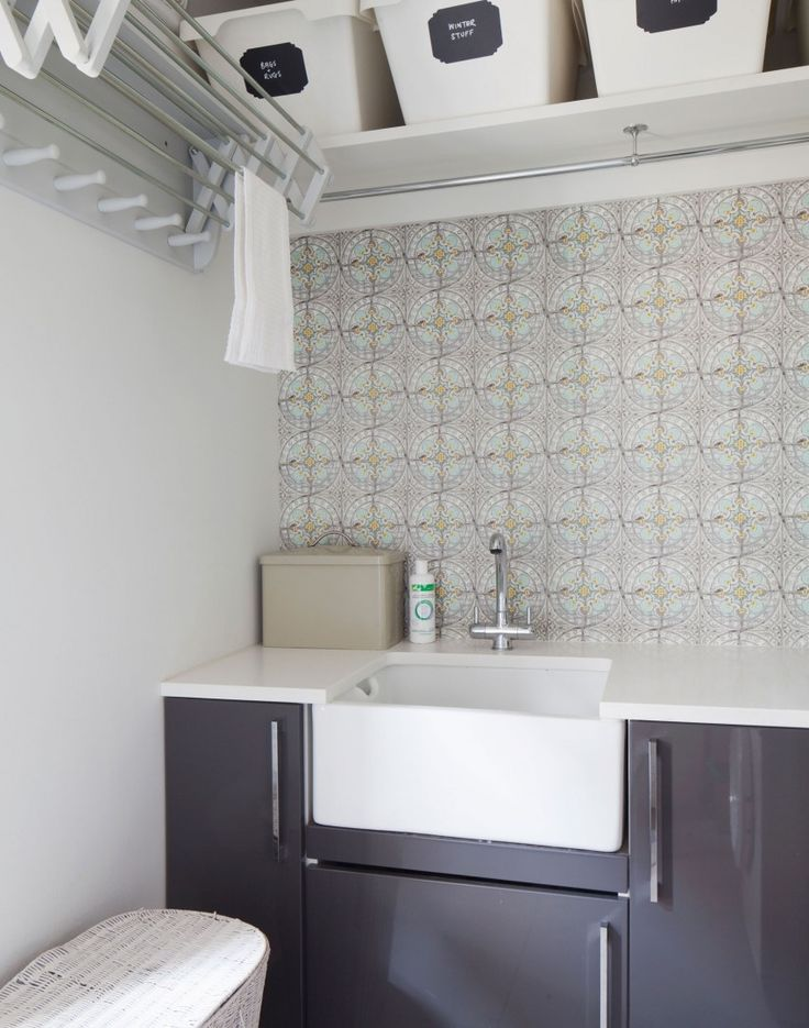 Organised Neutral Utility Room with Pale Moroccan Tiles