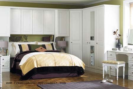 White wardrobe cabinets surround this bed Loads of