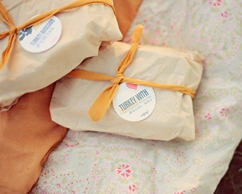 From Design*Sponge: California Wedding. It's outside, and the reception is picnic-style. I dig the wrapping of the sandwiches and various other paper goods (not pictured).