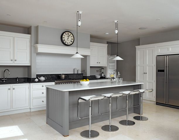I love the simplicity of the colour scheme in the Martin Moore kitchen. A lovely soft grey contrasted with black and white. CD.