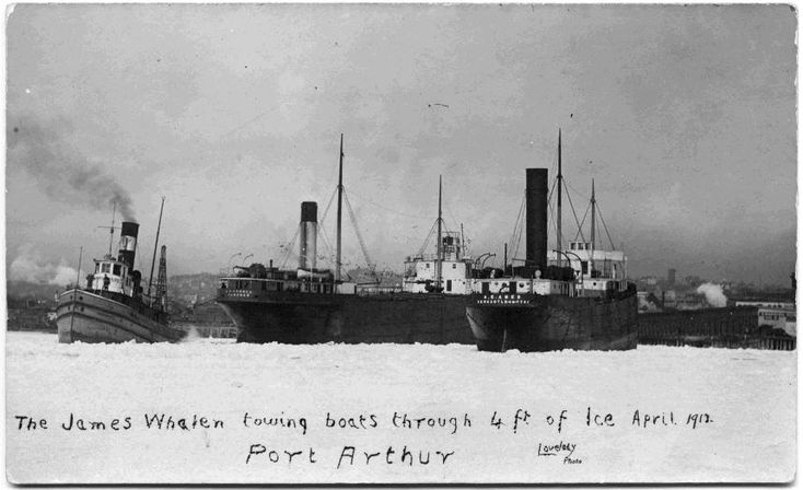 https://flic.kr/p/qEkkib | James Whalen Towing Boats, 1912. | Date: April 1912 Description: In this photograph, the James Whalen (far left), a tugboat and ice breaker, tows a ship many times its size through approximately 4 feet of ice. In addition to its regular duties, the James Whalen and her crew played a critical role in many rescue and salvage operations on Lake Superior. She was the first local vessel to be outfitted with wireless radio. This new tool allowed other ships to alert t...