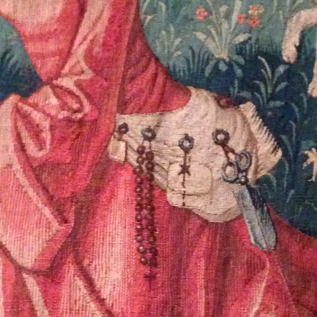 Detail of woman's tool belt from medieval pastoral tapestry, includes scissors…