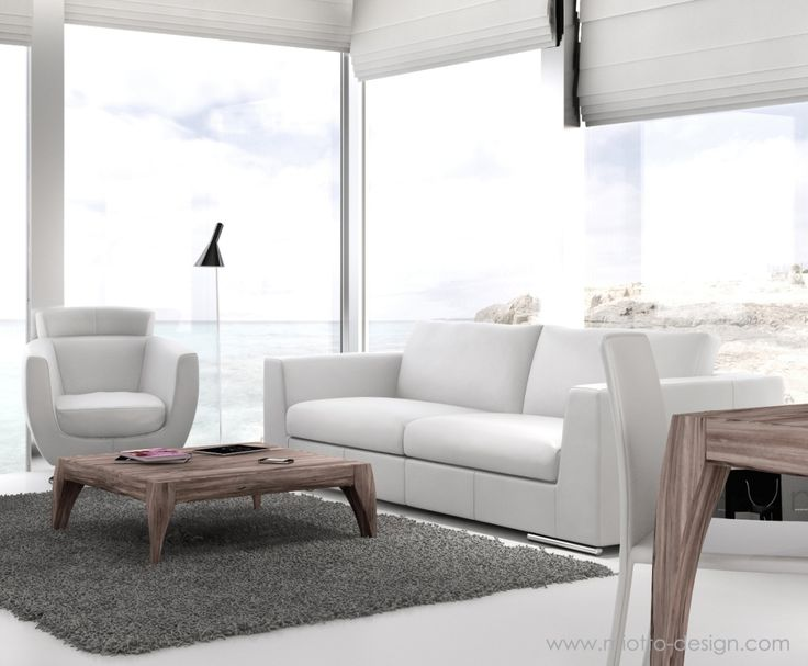 A Nice Living Room With A Sea View. White Leather Sofa And Laisure Chair  With