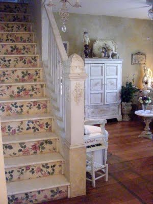 Wallpapered stair risers in a farmhouse