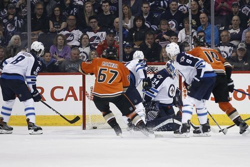 AP                  Published 11:24 p.m. ET March 30, 2017 | Updated 7 hours ago        Anaheim Ducks' Corey Perry (10) scores on Winnipeg Jets goalie Michael Hutchinson (34) as Jacob Trouba (8), Brandon Tanev (13) and Andrew Copp (9) defend during the second period of an NHL...  http://usa.swengen.com/scheifele-scores-winner-jets-rally-to-beat-ducks-4-3-in-ot/