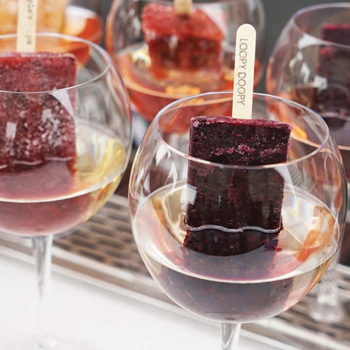 10 Boozy Popsicles to Make Summer Perfect: When it's hot out, there's nothing like an icy treat, ideally jazzed up with just a hint of liquor. Grown-up lollies have been all the rage this summer, showing up in a litany of flavors from banana and creamsicle to yuzu Margarita and as garnishes in sparkling wine and other drinks. So it's finally time for the grown-ups to have a little fun, and these 10 Popsicles prove it.