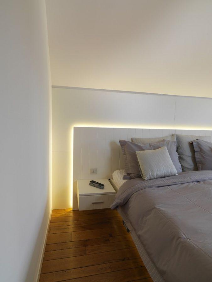 Verlichting achter hoofdbord bed