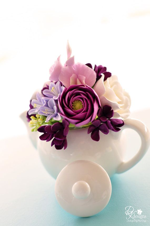 Mini teapot with purples and white - sweet peas, ranunculus, garden roses, hyacinth and lilac.