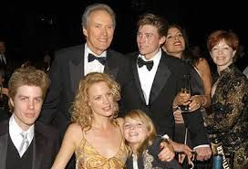 Clint Eastwood has 7 children,5 shown, 5 girls and 2 boys with various ex wives and partners of which ex partner Frances Fisher still a friend, is pictured far right and is the mother of their daughter Francesca.