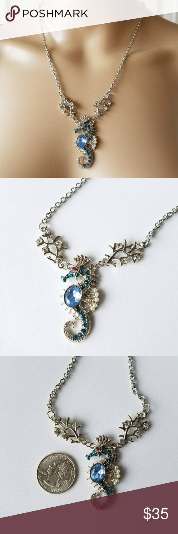 BLUE Topaz SILVER Seahorse Pendant Necklace Nautical ocean themed necklace depicting a beautiful seahorses surrounded by coral covered in rhinestones. The seahorse has a faux blue topaz aquamarine body and small dark blue simulated sapphires. Little ruby red eye gemstones. Detailed simple dainty sea animal boho bohemian hippy hippie gypsy Jewelry Necklaces