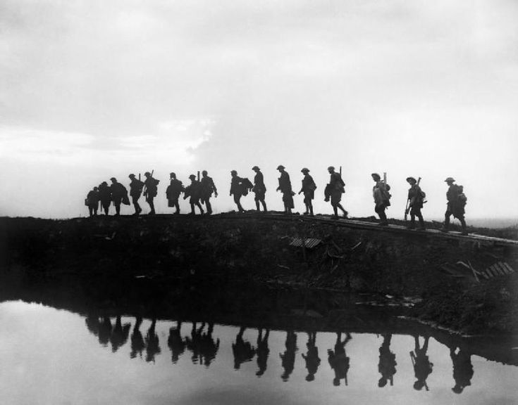 Supporting troops of the 1st Australian Division walking on a duckboard track near Hooge, in the Ypres Sector. As they passed toward the front line to relieve their comrades, whose attack the day before won Broodseinde Ridge and deepened the Australian advance. They are relievieng troops who had taken part in the Battle of Broodseinde.