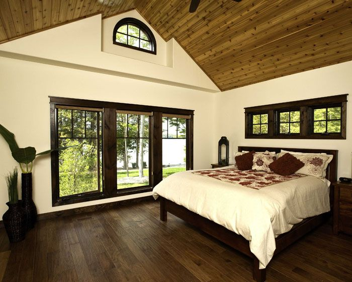 Red Leaves master bedroom. Vaulted ceiling with cedar liner. Dark stained wood windows with craftsman style grills. Dark wood floors contrast with cedar ceiling. http://www.linwoodhomes.com/house-plans/plans/red-leaves/