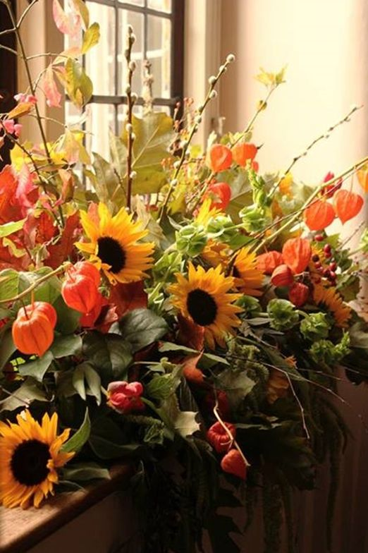 Seasonal autumn display of sunflowers, leaves and Chinese Lanterns from Bramble & Berry