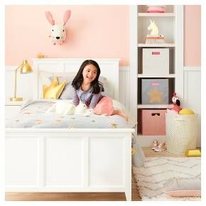 Pink and gold are a totally cute and playful pair, plus the dynamic-duo works with other neutrals. Foil-printed pillows and sheets, pink storage bins, and a chevron rug make a room that's ready for royalty.