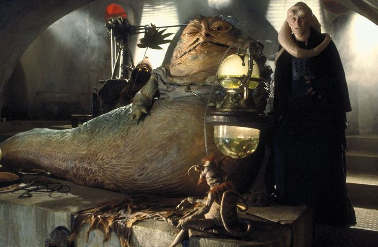 Jabba the Hutt, with his major-domo Bib Fortuna to his right.