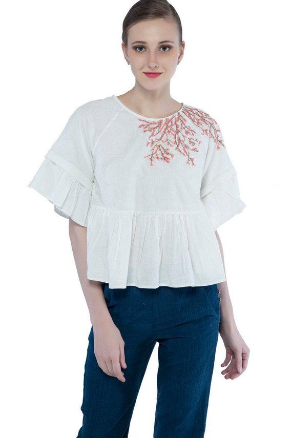 a094da86399 women white khadi cotton ruffled sleeve peplum top with floral hand  embroidery, workwear outfit, gif