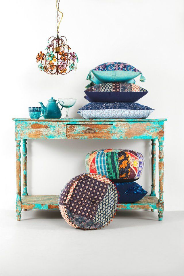 Indian style: for the console table and the more solid pillows (minus some of the warm colors, the chandelier, and some of the contrasty prints).