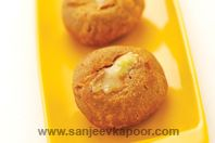 Rajasthani Bati - Baked whole wheat balls served dunked in pure ghee with Rajasthani dal - a speciality.