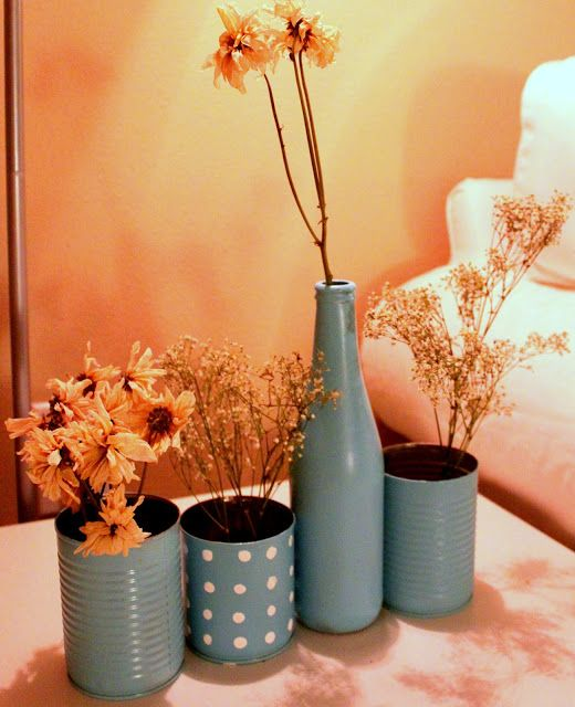 spray paint tin cans, fill with river pebbles and dried flowers. (or fresh flowers in the kitchen window)
