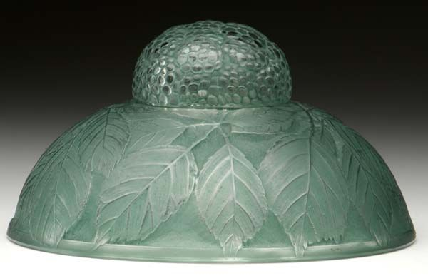 RENE LALIQUE `Cernay` inkwell of clear and frosted glass with green patina, c. 1924. M p. 318, No. 437. Molded R. LALIQUE. 6` dia.