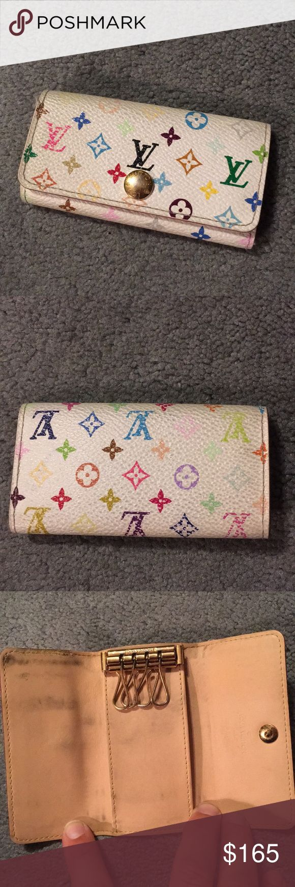 """LV multicolor 4 key holder Guaranteed authentic preowned white multicolor four key holder.  Shows some wear inside - shown in photos, please review carefully before purchasing.  Still looks great while carrying!!  Offers please use offer option only.  4 x2.25"""" Louis Vuitton Accessories Key & Card Holders"""