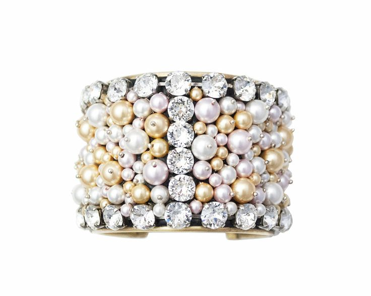 This bracelet is made of brass with a shinning finish studded with Swarovski ® Elements Crystal and Swarovski Elements® pearls in shades like Rosaline, Gold, White with different sizes and set in Ceralun™ (high-performance ceramic epoxy composite developed for the application of Swarovski Elements®). The bangle Soave is 100% Nickel Free, Lead Free and Cadmium Free. Size S-M, inside diameter 60mm.