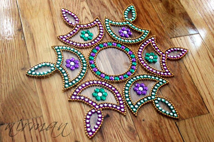 Kundan Rangoli floor art set of 7 pieces Indian diya by Nirman