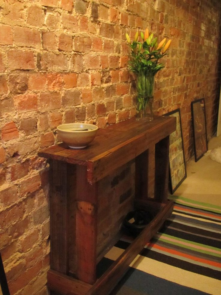Pallet Table On Exposed Brick Wall