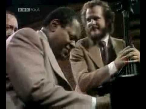 Oscar Peterson - Boogie Blues Etude, 1974. At Ronnie Scott's Club. with Neils Pedersen-bass and Barney Kessell-guitar. What an amazing tour-de-force!! Every style! A musical dictionary!