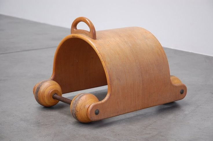 Very nice shaped kids car toy, probably made by Aarikka Finland in the 1970s. This heavy plywood kids car was made of high quality beech plywood and has very cool wooden wheels. This would be a very nice piece of decoration in any interior or just a cool toy for your kids