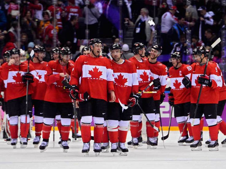 The Canadian team celebrates on the ice after beating the USA in the Semifinal match between the USA and Canada at the Bolshoy Ice Dome in the Men's Ice Hockey tournament at the Sochi 2014 Olympic Games, Sochi, Russia, 21 February 2014.